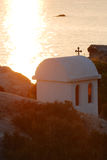 Greek chapel on seashore Stock Photography