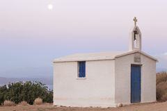 Greek chapel at sunset with full moon. Crete Royalty Free Stock Photography
