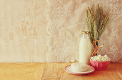 Greek cheese , bulgarian cheese and milk on wooden table over wooden textured background. Symbols of jewish holiday - Shavuot Stock Images
