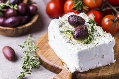 Greek cheese feta with thyme and olives. Selective focus royalty free stock image