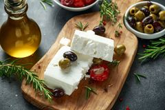 Greek cheese feta with thyme, rosemary, olives and stuffed red bell peppers Royalty Free Stock Photos