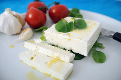 Greek Cheese and Olive Oil. Feta cheese, olive oil, garlic and tomatoes Royalty Free Stock Photo
