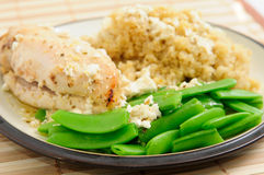 Greek chicken with quinoa , peas and feta cheese Royalty Free Stock Photos