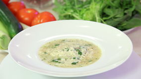 Greek chicken soup in a bowl stock video