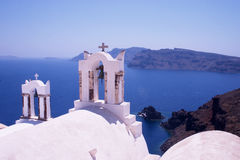 Greek Church 1. A church in Ia (Oia), Santorini, Greece, overlooking the caldera. The island of Thirasia is in the background royalty free stock photos
