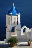 Greek Church. Photo of Greek church in Oia with sea background, Santorini island, Greece Royalty Free Stock Image