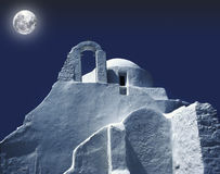 Greek church. Photographed at night with big moon casting shadows on church Stock Photo
