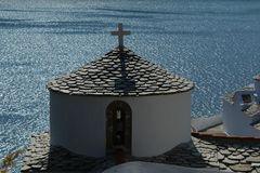Greek church above the sea Stock Photos