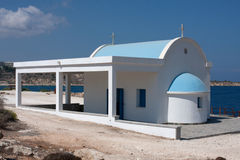 Greek church on the beach Stock Images