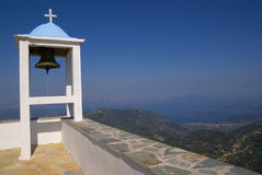 Greek church bell. And view of the islands Royalty Free Stock Photos