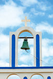 Greek church bell against blue sky Stock Image