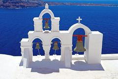 Greek church bells. Architecture of Oia village at Santorini island, Greece Royalty Free Stock Photography