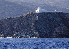 Greek church on coastline Royalty Free Stock Photography