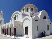 Greek Church on Crete island. Typical Greek church on Crete island, Greece with a scooter and blue skies Royalty Free Stock Photo