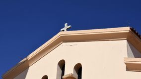 Greek church with cross. Church church with cross. Church and background of blue sky. Greek orthodox church royalty free stock photos