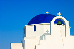 Greek Church Dome. The facade and dark blue dome of a traditional church on the Greek island of Antiparos Stock Image