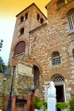 Greek church exterior. St. Martyr Demetrius church input,Metropolitan bust in front Royalty Free Stock Photo