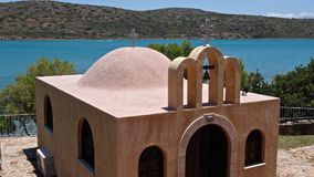 Greek church on the island of Crete. Against a background of the sea Royalty Free Stock Photo