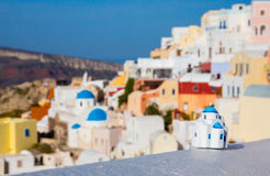 Greek church with a miniature souvenir house Royalty Free Stock Image