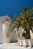 Greek church and palm Royalty Free Stock Images