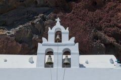 Greek church with red rock behind. Santorini, Greece. Europe stock photos