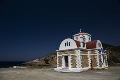 Greek church on the shore Stock Images