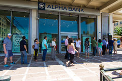 Greek citizens line up at an ATM Stock Photos