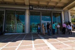 Greek citizens line up at an ATM Stock Image