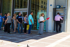 Greek citizens line up at an ATM Royalty Free Stock Photo