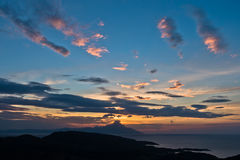 Greek coast of aegean sea at sunrise near holy mountain Athos Stock Photos