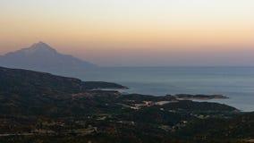 Greek coast of aegean sea at sunset near holy mountain Athos stock photo