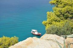 Greek coast, ship under a rock. stock photos