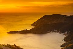 Greek coast at sunrise Peloponnese Mani. Greek coastline at early morning sun rising, Greece Peloponnese Mani. Beautiful landscape natural scenery royalty free stock photography