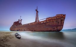 Greek coastline with the famous rusty shipwreck in Glyfada beach near Gytheio, Gythio Laconia Peloponnese. Greek coastline with the famous rusty shipwreck in royalty free stock image