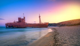 Greek coastline with the famous rusty shipwreck in Glyfada beach near Gytheio, Gythio Laconia Peloponnese. Greek coastline with the famous rusty shipwreck in stock photo