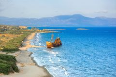 Greek coastline with the famous rusty shipwreck in Glyfada beach near Gytheio, Gythio Laconia Peloponnese. Greek coastline with the famous rusty shipwreck in royalty free stock photo