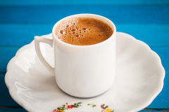 Greek coffee on a blue table Stock Photography