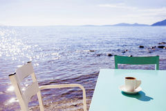 Greek coffee in a cafe near the sea. A cup of traditional greek coffee  against the sea Stock Photo