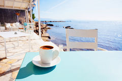 Greek coffee in a cafe near the sea. A cup of traditional greek coffee  against the sea Royalty Free Stock Photo