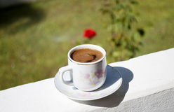 Greek coffee. A cup of greek coffee on a sunny day Royalty Free Stock Image