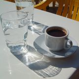 Coffee and a glass of water. Greek coffee served in a cafe in Cyprus Royalty Free Stock Images