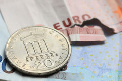 Greek coins on euro notes Royalty Free Stock Photos