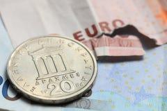 Greek coins on euro notes Royalty Free Stock Photos