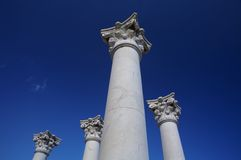 Greek column. Ancient  four greek column with blue sky Stock Photography