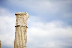 Greek column. Details of a column against the sky Stock Images