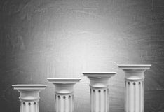 Greek columns, blackboard background. Greek columns of different heights standing against a blackboard background. Concept of financial growth. 3d rendering mock Stock Photo