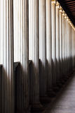 Greek columns in perspective Royalty Free Stock Photography