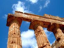 Greek columns in Sicily. Doric greek columns, architrave and metope belonging to the E temple in Selinunte (Agrigento royalty free stock photography