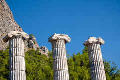 Greek columns. Three ancient Greek columns background. Temple of Athena in Priene, Turkey royalty free stock images