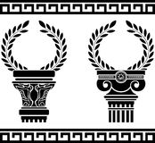Greek columns with wreaths Royalty Free Stock Image